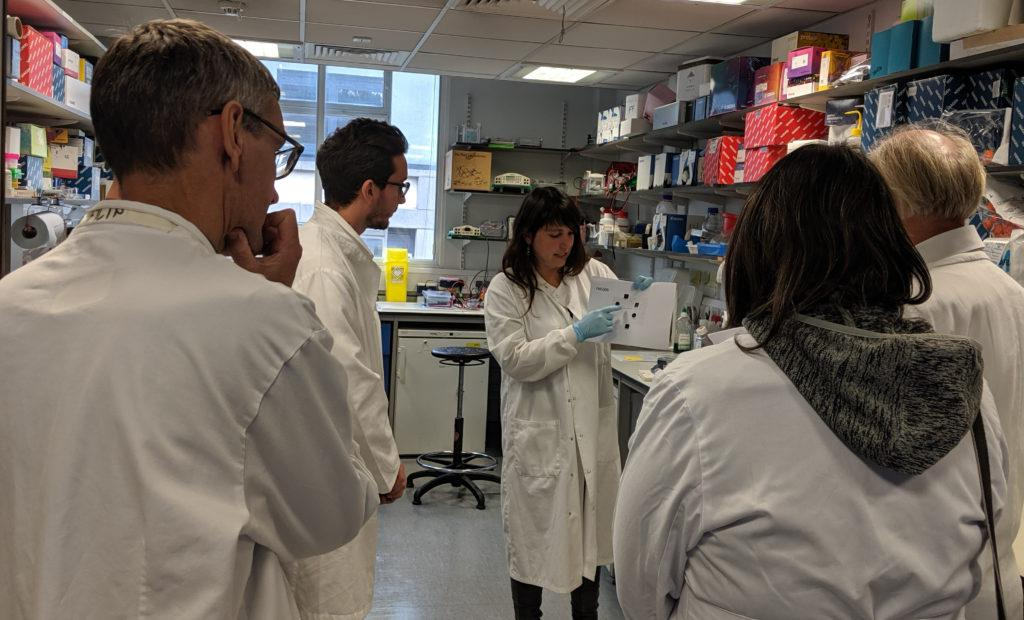 Dr Ana Rio-Machin explaining her work on familial leukaemia as part of the Bloodwise laboratory tour.