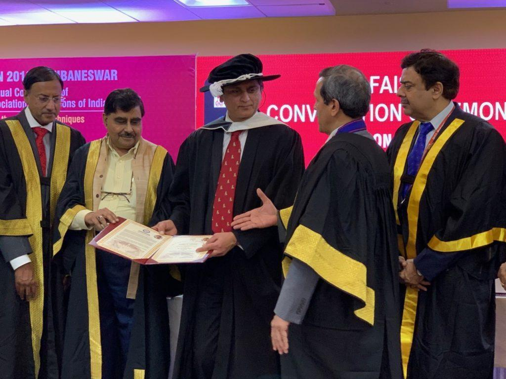 Professor Bijendra Patel receiving the Honorary Fellowship of the Association of Surgeons of India.
